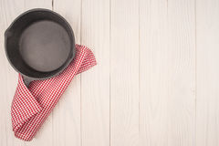 Empty pan on wooden deck table with tablecloth. Stock Photography