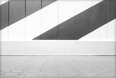Empty panel wall colored diagonally and tile floor Stock Photo