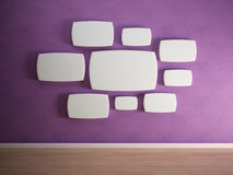 Empty panels on purple wall. Empty panels on a purple wall Royalty Free Stock Images