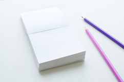 Empty paper block and two pencils on light background Royalty Free Stock Photography