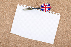 Empty Paper on Bulletin Board. Empty blank paper sheet english flag pinned on notice board Royalty Free Stock Image