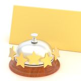 Empty paper card behind reception bell. Empty copyspace golden folded paper card behind the five star hotel silver reception bell over the white background Royalty Free Stock Photo