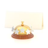 Empty paper card behind reception bell Stock Photo