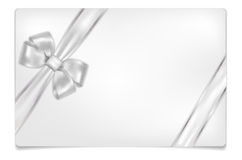 Empty paper card with shiny silver bow Stock Image