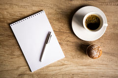Empty paper with cup of coffee on wooden table Royalty Free Stock Image