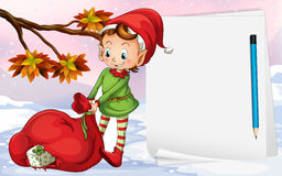 An empty paper beside the elf. With a bag of gifts Stock Photography