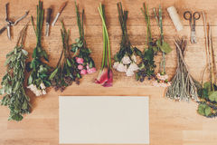 Empty paper and flowers bouquets on white wood Royalty Free Stock Photo