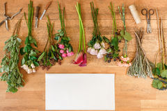 Empty paper and flowers bouquets on white wood Royalty Free Stock Images