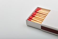 Empty paper matchbox with wooden matches on it. Matchbook case p Royalty Free Stock Photos