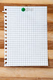 Empty paper message with push pin on the wooden board as backgro Royalty Free Stock Image