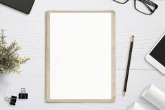Empty paper mockup, on old folder, white wooden work desk stock photo