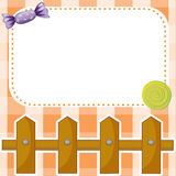 An empty paper note with candies and a wooden fence Royalty Free Stock Images