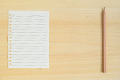 Empty paper note with pencil on wood background Stock Images