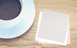 Empty paper note on wood table Royalty Free Stock Image