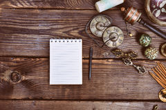 Empty paper notebook and Tibetan religious musical instruments royalty free stock photos