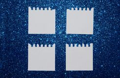 Empty paper notes on blue glitter background Stock Photography