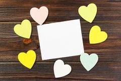 Empty paper over wooden background with colorful heart on valentines day Stock Images