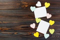 Empty paper over wooden background with colorful heart on valentines day Royalty Free Stock Photos