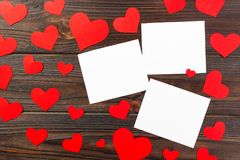 Empty paper over wooden background with colorful heart on valentines day Royalty Free Stock Images