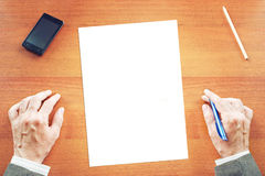 Empty paper sheet on a desk and man ready Royalty Free Stock Images