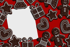 Empty paper sheet with gingerbread cookies. Lying on red tablecloth Stock Images