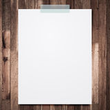 Empty paper sheet stick on wood background. Royalty Free Stock Photos