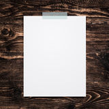 Empty paper sheet stick on wood background. Royalty Free Stock Images