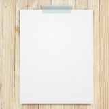 Empty paper sheet stick on wood background. Stock Photos