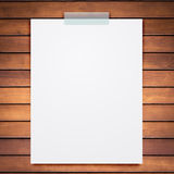 Empty paper sheet stick on wood background. Royalty Free Stock Photo