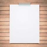 Empty paper sheet stick on wood background. Stock Image