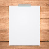 Empty paper sheet stick on wood background. Royalty Free Stock Photography