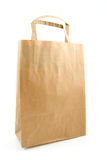 Empty paper shopping bag Stock Images