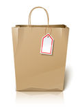 Empty paper shopping bag with label Royalty Free Stock Photos