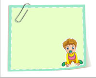 An empty paper template with a paper clip and a young boy Stock Image