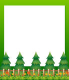 An empty paper template with pine trees and a garden at the bott Stock Photo