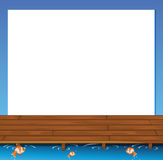 An empty paper template with a wooden bridge and fishes at the b Stock Images