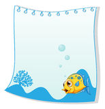 An empty paper with a yellow fish at the bottom. Illustration of an empty paper with a yellow fish at the bottom on a white background Royalty Free Stock Image
