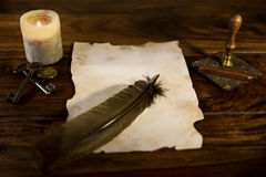Empty parchment document with feather Stock Photo