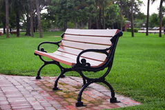 Empty Park Bench. An Empty Park bench on a wet cloudy day right after the grass was cut Stock Photos