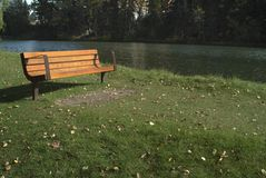 Empty park bench. Empty bench in the park near river Royalty Free Stock Images