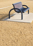 Empty Park Bench. Empty Blue metal park bench with sand royalty free stock image
