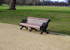 Empty park bench. A lone park bench in the park Royalty Free Stock Image