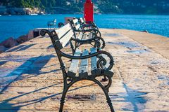 Empty park bench in Dubrovnik stock photography