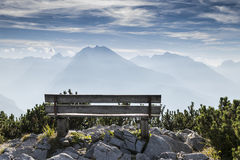 Empty park bench in high mountains Royalty Free Stock Image