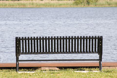 Empty park bench near hudson river. In new york on a bright sunny day Stock Photo