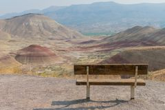 Empty Park Bench in Painted Hills with Copy Space. To left royalty free stock image