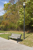 Empty Park bench in park Stock Image