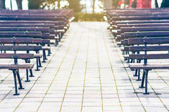 Empty park benches rows in front of an open air stage. Bulgaria, Bourgas, Sea Garden. Royalty Free Stock Images