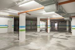 Empty parking area on underground garage.  Royalty Free Stock Image