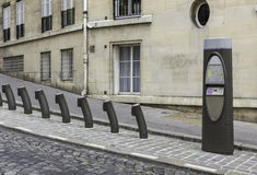 Empty parking of bicycles for rent in Paris Stock Image